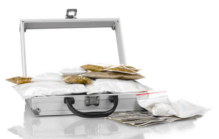 Cocaine and marijuana in a suitcase isolated on white photo