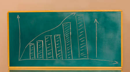 Growth chart is drawn on the blackboard isolated on white Stock Photo - 13994578