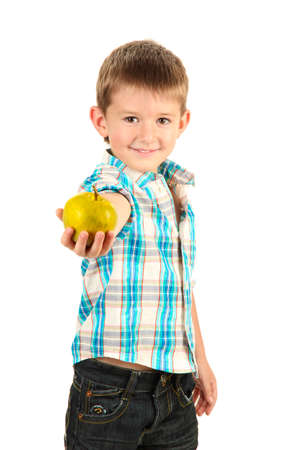 funny little boy with apple isolated on white photo