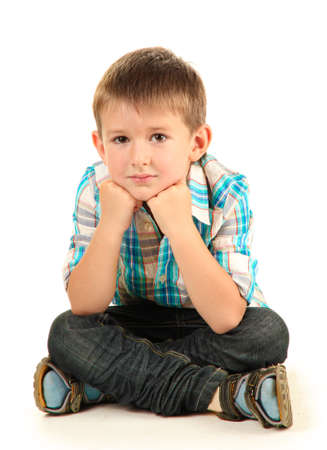 sitting on floor: funny little boy with headphones isolated on white