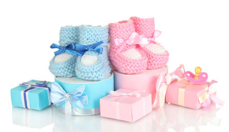 baby boots, pacifier, gifts and blank postcard  isolated on white Stock Photo - 14032185
