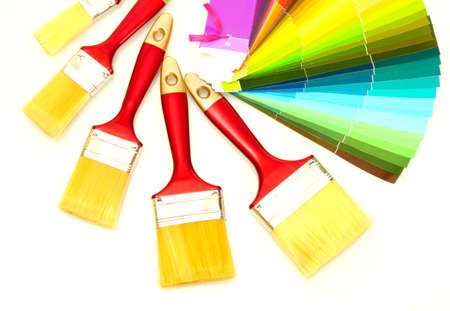 paint brushes and bright palette of colors isolated on white photo