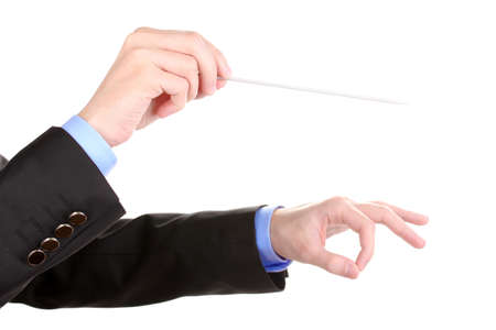 Music conductor hands with baton isolated on white photo