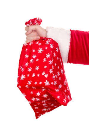 Santa Claus hand holding bag of gifts isolated on white photo