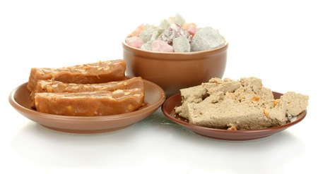 East sweets - halva, sherbet and Turkish delight isolated on white photo