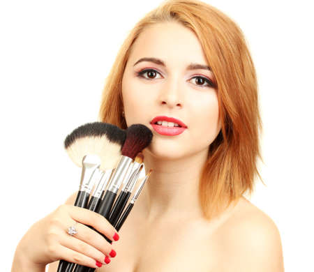 portrait of beautiful woman   with make-up brushes photo