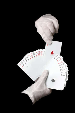 Cards in hands isolated on black Stock Photo - 14030904