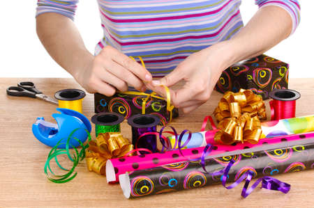 gift wrapping: Wrapping presents surrounded by  paper, ribbon and bows