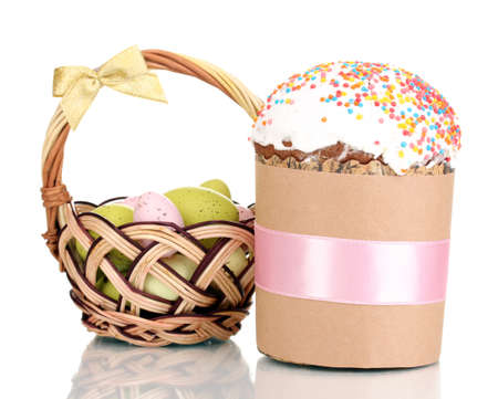 Beautiful Easter cake with eggs in basket isolated on white photo