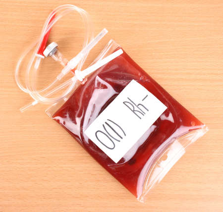 blood supply: Bag of blood and infusion on wooden background