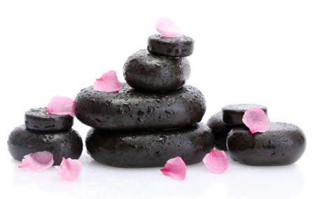 Spa stones with drops and pink petals isolated on white  photo