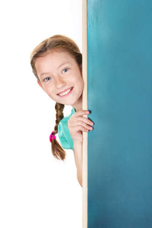 schooler: Portrait of beautiful little girl. Isolated on white