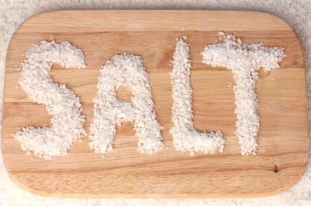 sediments: Sea salt on a cutting board close-up Stock Photo