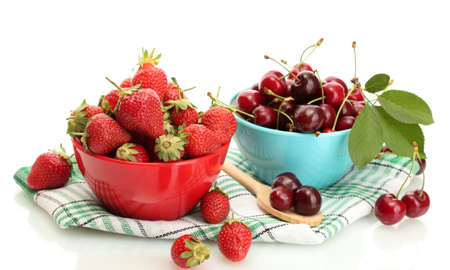 Ripe strawberries and cherry berries in bowls isolated on white Stock Photo - 14042725