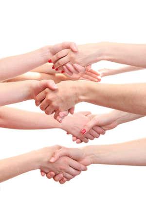 manos estrechadas: grupo de las manos de los jóvenes aislados en blanco Foto de archivo