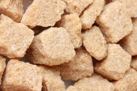 brown cane sugar cubes background close-up photo