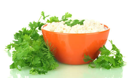 cottage cheese with parsley and dill in orange bowl isolated on white Stock Photo - 14052459