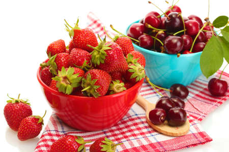 Ripe strawberries and cherry berries in bowls isolated on white Stock Photo - 14055235