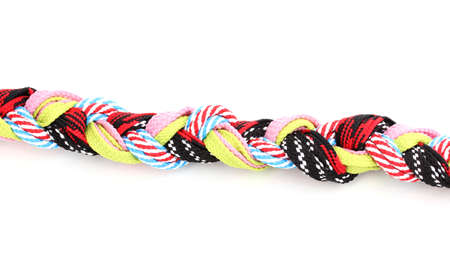 Colorful shoelaces in pigtail isolated on white photo