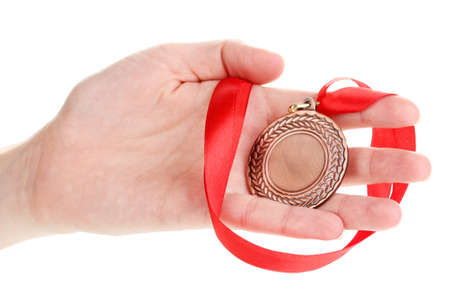 Bronze medal in hand isolated on white Stock Photo - 14054395