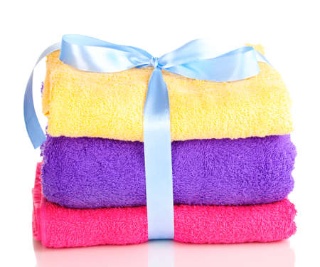 Colorful towels with ribbon isolated on white Stock Photo - 14055249