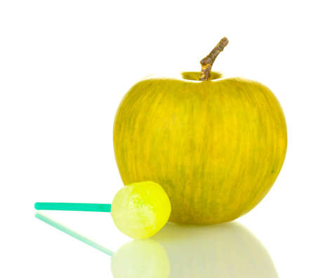 Candy flavored with apple and apple isolated on white Stock Photo - 14088887
