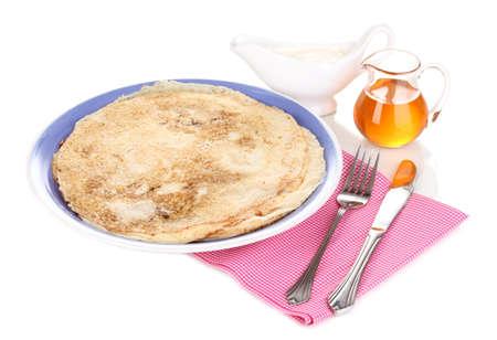 Stack of tasty pancakes isolated on white photo