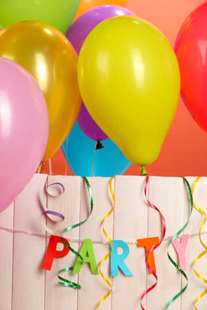 party balloons: Party. Balloons on white wooden background close-up