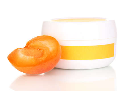 Jar of cream with juicy apricot isolated on white photo