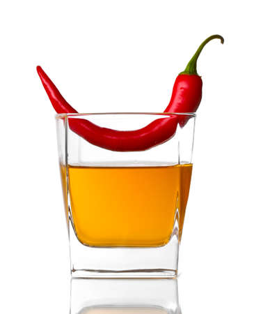 Glass with red hot chili pepper isolated on white photo