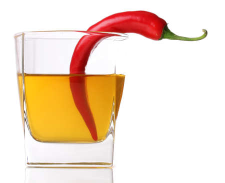 Glass with red hot chili pepper isolated on white Stock Photo - 14088300