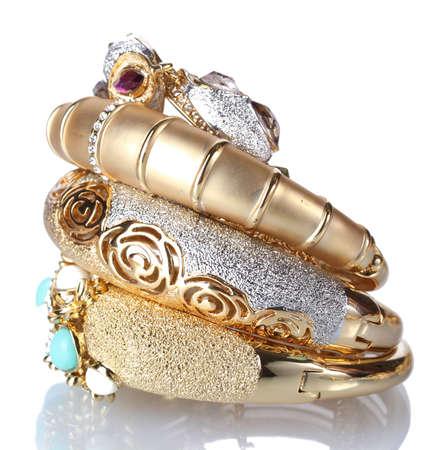 Beautiful golden bracelets isolated on white Stock Photo - 14090550