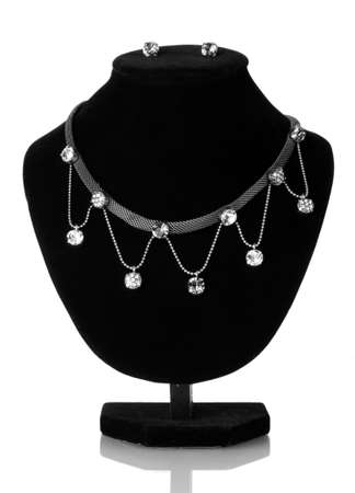 beautiful silver necklace  and earrings on mannequin isolated on white photo