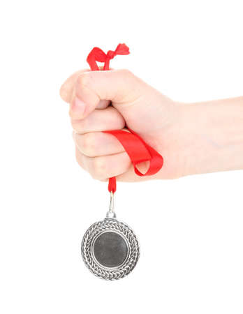 Silver medal in hand isolated on white Stock Photo - 14096615