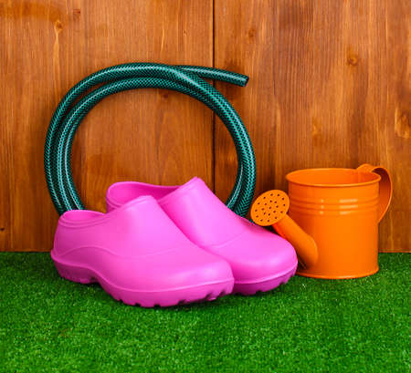 Gardening tools on wooden background photo