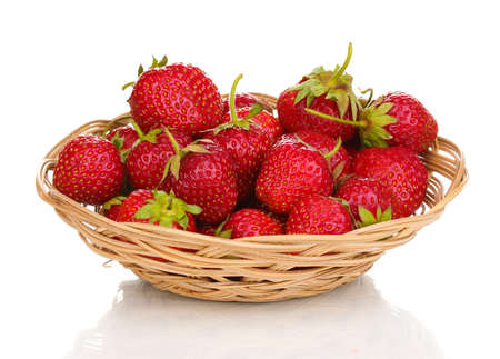 Sweet ripe strawberries in basket isolated on white photo