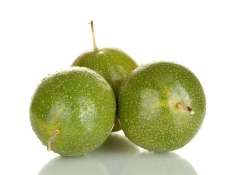 three green passion fruit isolated on white photo
