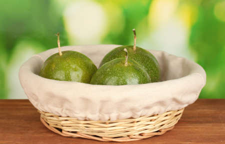 green passion fruit on green background photo