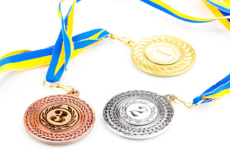 Three medals isolated on white Stock Photo - 14116486