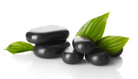Spa stones and green leaves isolated on white Stock Photo - 14114937