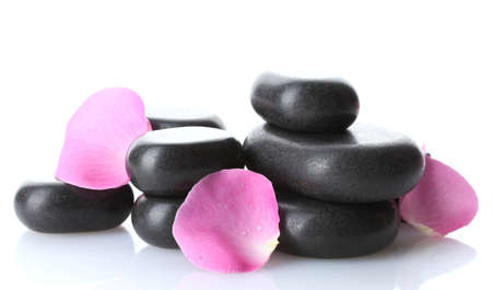 Spa stones and rose petals isolated on white photo