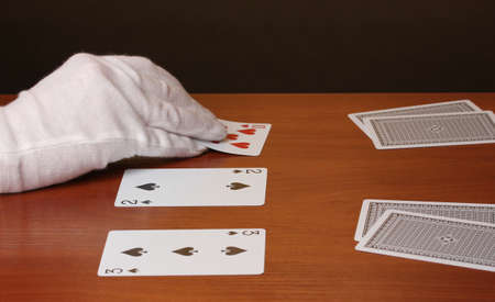 Cards and hand on brown background photo