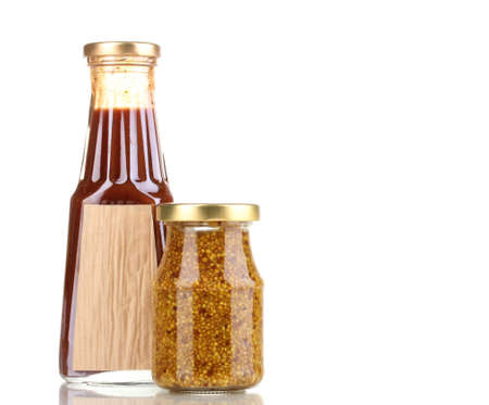 distinctive flavor: Tomato sauce and mustard in glass bottles isolated on white Stock Photo