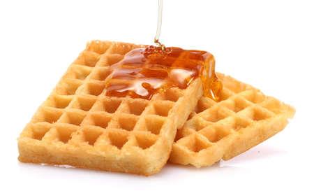 belgium waffles with honey isolated on white photo
