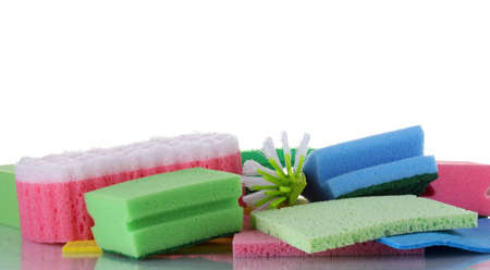Many colorful sponges and brushes for housework isolated on white photo