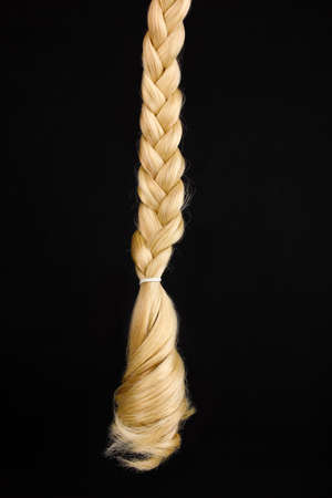 blond streaks: Blond hair braided in pigtail isolated on black