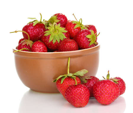 Sweet ripe strawberries in glass bowl isolated on white photo