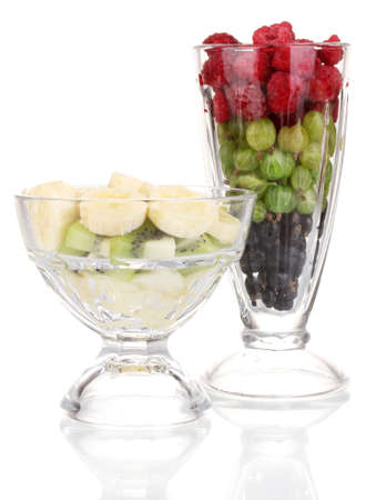 Mixed fruits and berries in glasses isolated on white photo