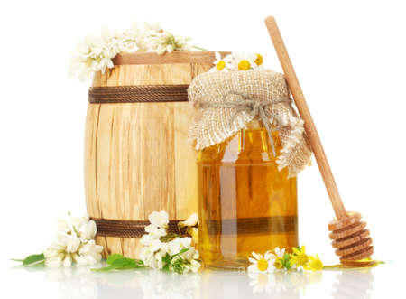 honey jar: Sweet honey in barrel and jar with acacia flowers isolated on white