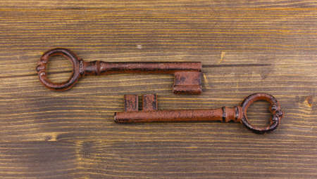 Two antique key on wooden background Stock Photo - 14159667
